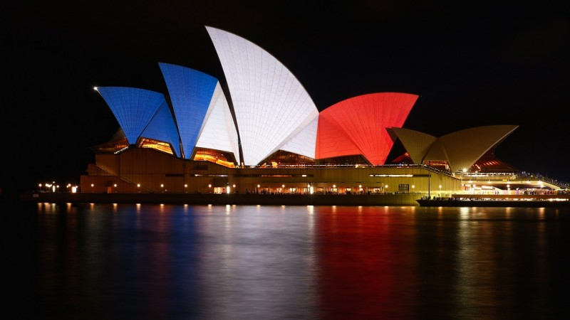 The sails of the Sydney Opera House are illuminated in the colours of the French flag on November 14, 2015 in Sydney, Australia. At least 120 people have been killed and over 200 are injured in Paris following a series of terrorist acts in the French capital on Friday.