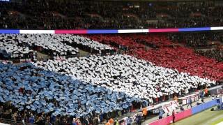 LONDON, ENGLAND - NOVEMBER 17: Fans of England display the national flag of France during the international friendly between England and France at Wembley Stadium on November 17, 2015 in London, England. Yunus Kaymaz / Anadolu Agency