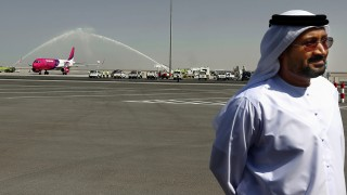 Low cost Hungarian Wizz Air airliner receives a water salute as it lands on the newly opened Al-Maktoum International airport, the emirate's second airport  in Dubai, on October 27, 2013. The new passenger terminal opened its doors for business following an official inauguration and welcome of the first commercial flight.        AFP PHOTO/MARWAN NAAMANI / AFP / MARWAN NAAMANI