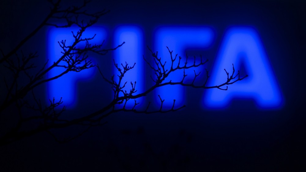 This photo taken on December 3, 2015 in Zurich shows a sign outside of the FIFA headquarters.  The unprecedented corruption scandal engulfing FIFA widened on December 3 with the arrests of two more top officials in another dramatic dawn raid at a luxury hotel in Zurich.   / AFP / FABRICE COFFRINI