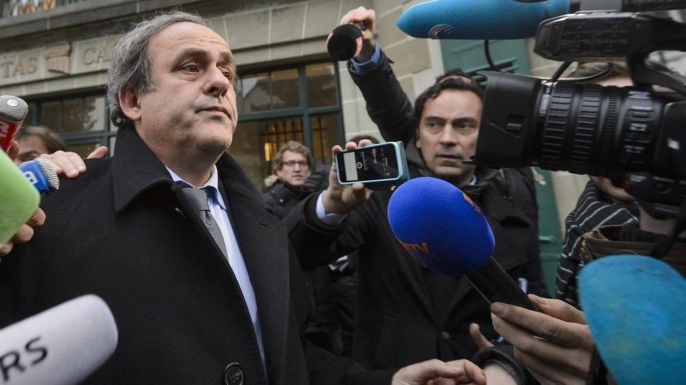 A photo taken on December 8, 2015 shows UEFA president Michel Platini answering journalists' questions upon his arrival to the Court of Arbitration for Sport (CAS) in Lausanne. Joseph Blatter, president of the Fifa since 1998 and Michel Platini, president of the UEFA since 2007, were banned by FIFA for eight years on December 21, 2015. / AFP / FABRICE COFFRINI