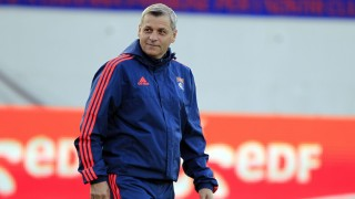 (FILES) This file photo taken on December 20, 2015 shows Lyon's assistant coach Bruno Genesio walking prior to the French L1 football match between Gazelec Ajaccio (GFCA) and Lyon (OL)  at the Ange Casanova stadium in Ajaccio, on the French Mediterranean island of Corsica. Bruno Genesio will replace Hubert Fournier as Lyon's coach, the club announced on december 24, 2015. / AFP / Pascal POCHARD-CASABIANCA
