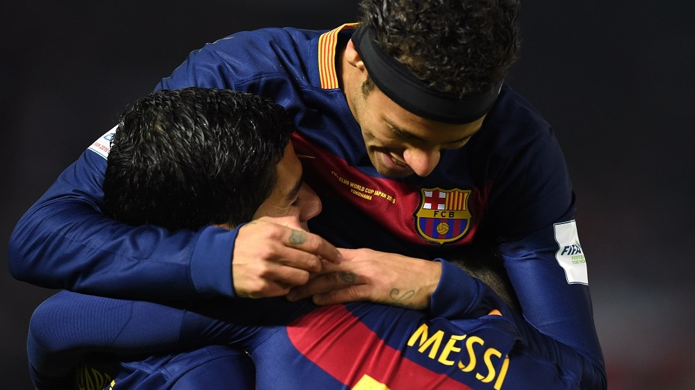 Barcelona forward Luis Suarez (L) celebrates his goal with Barcelona forward Lionel Messi and Barcelona forward Neymar (top) during the Club World Cup football final against River Plate in Yokohama on December 20, 2015.  AFP PHOTO / TOSHIFUMI KITAMURA / AFP / TOSHIFUMI KITAMURA