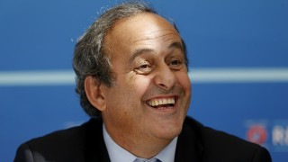 UEFA chief Michel Platini speaks during a UEFA press conference after the draw for the UEFA Europa League football group stage 2015/16 on August 28, 2015 in Monaco.  AFP PHOTO / VALERY HACHE / AFP / VALERY HACHE