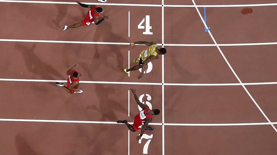 """-- AFP PICTURES OF THE YEAR 2015 -- (from bottom) USA's Justin Gatlin, USA's Tyson Gay, Jamaica's Usain Bolt, USA's Mike Rodgers and USA's Trayvon Bromell compete in the final of the men's 100 metres athletics event at the 2015 IAAF World Championships at the """"Bird's Nest"""" National Stadium in Beijing on August 23, 2015.  AFP PHOTO / ANTONIN THUILLIER / AFP / ANTONIN THUILLIER"""