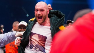 British Tyson Fury celebrates after the WBA, IBF, WBO and IBO title bout against Ukrainian world heavyweight boxing champion Wladimir Klitschko in Duesseldorf, western Germany, on November 28, 2015. Fury won the fight after 12 Rounds of Boxing.  AFP PHOTO / DPA / ROLF VENNENBERND  GERMANY OUT / AFP / DPA / ROLF VENNENBERND