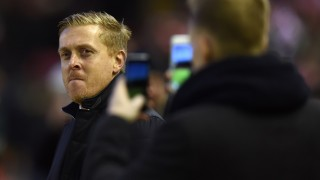 Swansea City's English manager Garry Monk looks on ahead of the English Premier League football match between Liverpool and Swansea City at the Anfield stadium in Liverpool, north-west England on November 29, 2015.   AFP PHOTO / PAUL ELLIS  RESTRICTED TO EDITORIAL USE. No use with unauthorized audio, video, data, fixture lists, club/league logos or 'live' services. Online in-match use limited to 75 images, no video emulation. No use in betting, games or single club/league/player publications. / AFP / PAUL ELLIS