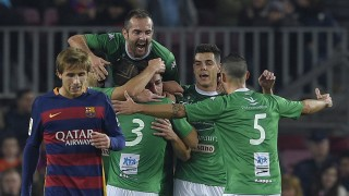 Villanovense's players celebrate after scoring a goal during the Spanish Copa del Rey (King's Cup) Round of 32 second leg football match FC Barcelona vs CF Villanovense at the Camp Nou stadium in Barcelona December 2, 2015. AFP PHOTO / LLUIS GENE / AFP / LLUIS GENE