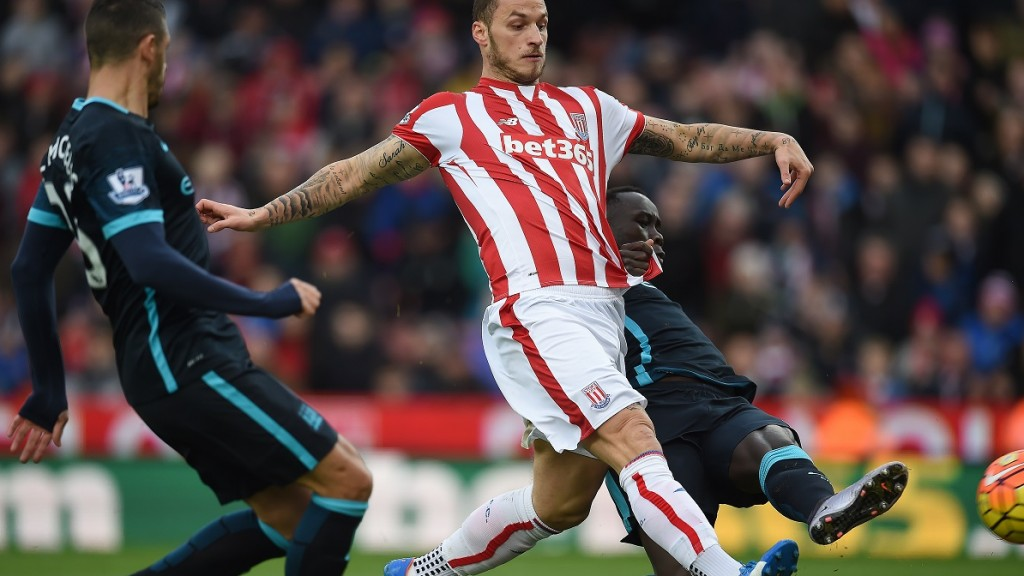 Stoke City's Austrian striker Marko Arnautovic (C) shoots and scores past Manchester City's French defender Bacary Sagna (R) during the English Premier League football match between Stoke City and Manchester City at the Britannia Stadium in Stoke-on-Trent, central England on December 5, 2015.      AFP PHOTO / PAUL ELLIS  RESTRICTED TO EDITORIAL USE. No use with unauthorized audio, video, data, fixture lists, club/league logos or 'live' services. Online in-match use limited to 75 images, no video emulation. No use in betting, games or single club/league/player publications.. / AFP / PAUL ELLIS
