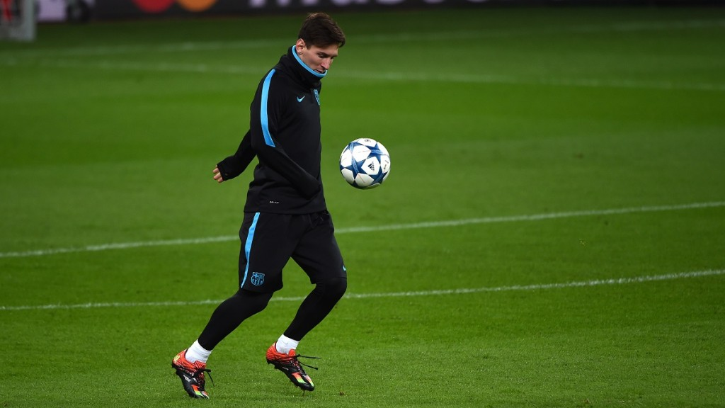 Argentinian striker Lionel Messi warms up during a training session on the eve of the Group E, second-leg UEFA Champions League football match Bayer Leverkusen vs FC Barcelona in Leverkusen, western Germany on December 8, 2015. AFP PHOTO / PATRIK STOLLARZ / AFP / PATRIK STOLLARZ