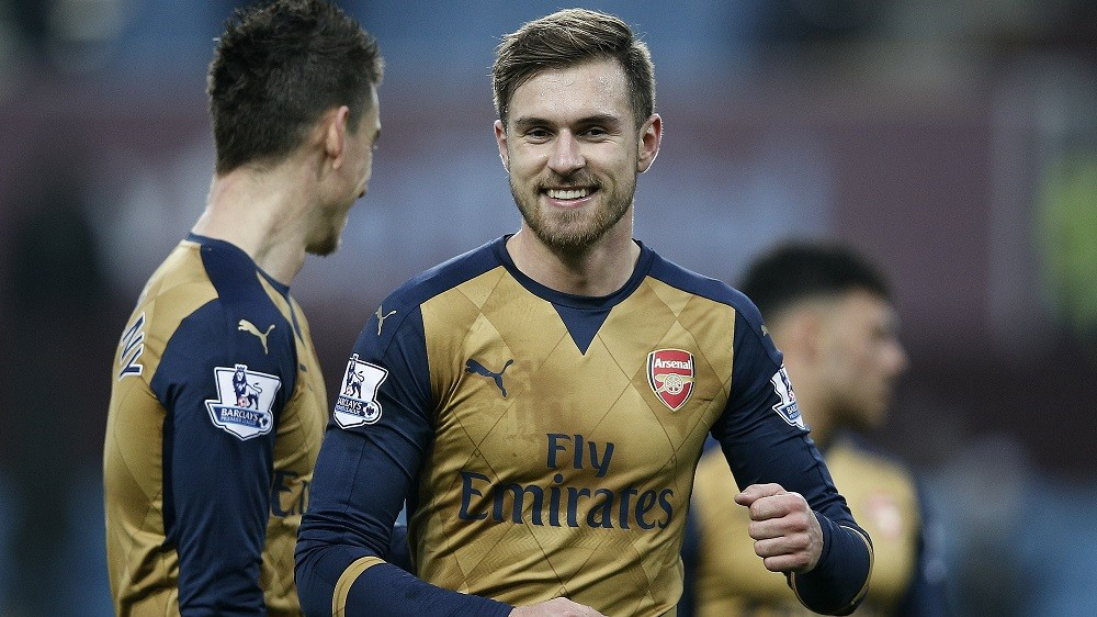 Arsenal's Welsh midfielder Aaron Ramsey (C) reacts following the English Premier League football match between Aston Villa and Arsenal at Villa Park in Birmingham, central England on December 13, 2015. Arsenal won the match 2-1.   AFP PHOTO / ADRIAN DENNIS  RESTRICTED TO EDITORIAL USE. No use with unauthorized audio, video, data, fixture lists, club/league logos or 'live' services. Online in-match use limited to 75 images, no video emulation. No use in betting, games or single club/league/player publications. / AFP / ADRIAN DENNIS
