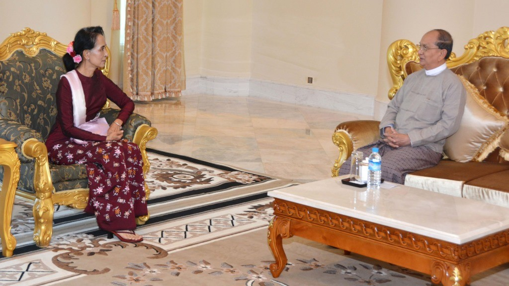 """In this photograph taken and released by the Myanmar News Agency (MNA) on December 2, 2015, Myanmar President Thein Sein (R) meets with Myanmar pro-democracy leader and National League for Democracy (NLD) party chairperson Aung San Suu Kyi in Naypyidaw on December 2, 2015. Myanmar's democracy leader Aung San Suu Kyi began talks with the nation's army-backed president on the handover of power December 2 nearly a month after her opposition party cleaned up at the polls. AFP PHOTO / MYANMAR NEWS AGENCY --- EDITORS NOTE ----- RESTRICTED TO EDITORIAL USE MANDATORY CREDIT """"AFP PHOTO / MYANMAR NEWS AGENCY"""" NO MARKETING NO ADVERTISING CAMPAIGNS - DISTRIBUTED AS A SERVICE TO CLIENTS -- / AFP / MYANMAR NEWS AGENCY / MYANMAR NEWS AGENCY"""