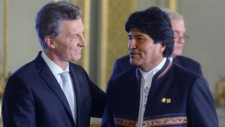 Argentina's President Mauricio Macri (L) is greeted by Bolivia's President Evo Morales during his inauguration ceremony, in Buenos Aires on December 10, 2015. Macri's inauguration marks the start of a new era for Argentina: a tilt to the right after 12 years under Kirchner and her late husband Nestor, the left-wing power couple that led the country back to stability after an economic meltdown in 2001.   AFP PHOTO/EITAN ABRAMOVICH / AFP / EITAN ABRAMOVICH