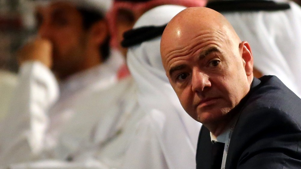 UEFA General Secretary Gianni Infantino sits with UAE officials as he attends the opening session of the 10th edition of Dubai International Sports Conference in Dubai on December 27, 2015. AFP PHOTO / MARWAN NAAMANI / AFP / MARWAN NAAMANI