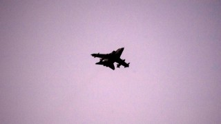 British Royal Air Force Tornado GR4 aircraft flys over the British airbase at Akrotiri, near Cyprus' second city of Limassol on December 3, 2015. Britain joined the US-led bombing campaign over Syria on December 3, hitting an oil field held by Islamic State jihadists just hours after a decisive parliamentary vote authorised air strikes. AFP PHOTO / IAKOVOS HATZISTAVROU / AFP / IAKOVOS HATZISTAVROU