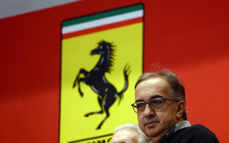 Chief Executive Officer of Fiat Chrysler Automobiles Group Sergio Marchionne waits to ring the opening bell at the New York Stock Exchange (NYSE) as Ferrari starts trading for the first day in New York on October 21, 2015. The Dow clung to a modest gain, but the Nasdaq fell early Wednesday as traders weighed big technology deals, mixed earnings and Ferrari's roaring debut on Wall Street. AFP PHOTO/JEWEL SAMAD / AFP / JEWEL SAMAD