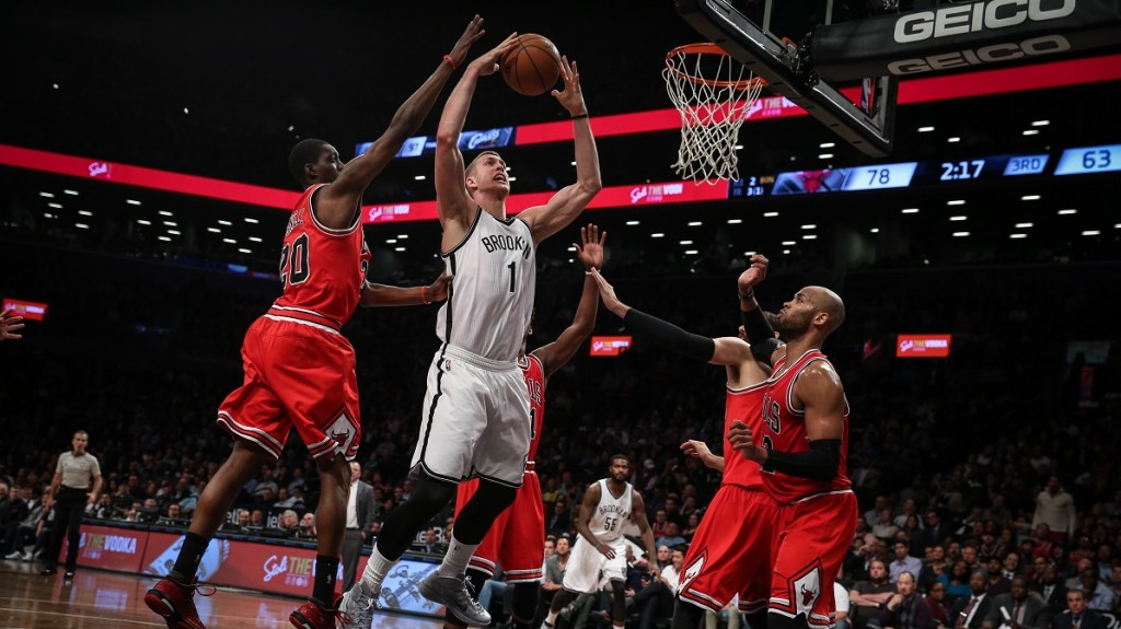 NEW YORK, UNITED STATES - APRIL 13: Mason Plumlee (C) of Brooklyn Nets in action against Tony Snell (20) and Taj Gibson (R) of Chicago Bulls during NBA basketball match between Brooklyn Nets and Aaron Brooks at Barclays Center in New York, on April 13, 2015. Cem Ozdel / Anadolu Agency