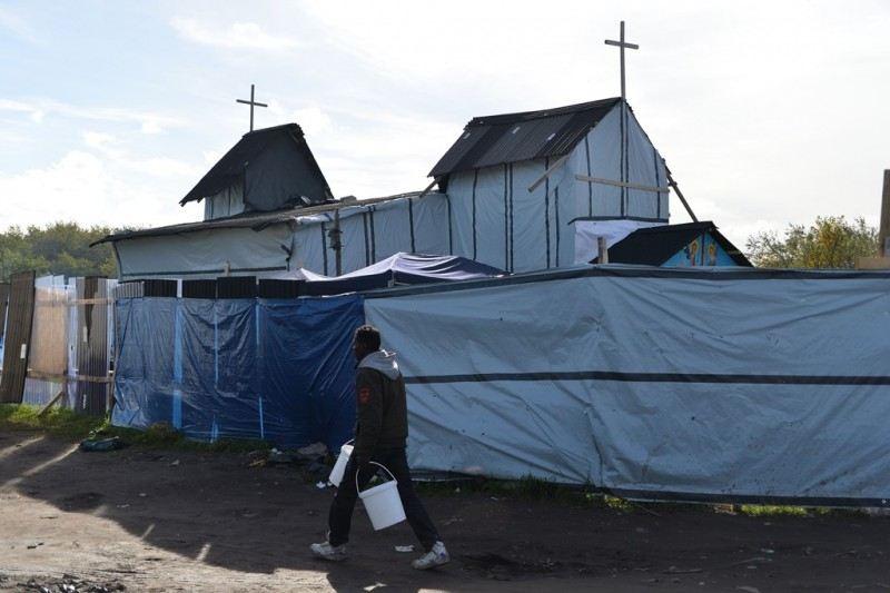 CALAIS, FRANCE - OCTOBER 25: A makeshift church is built by refugees hoping to reach the U.K, as they shelter at a refugee camp, also known as the Jungle, in the northern port city of Calais, France on October 25, 2015. Mustafa Yalcin / Anadolu Agency