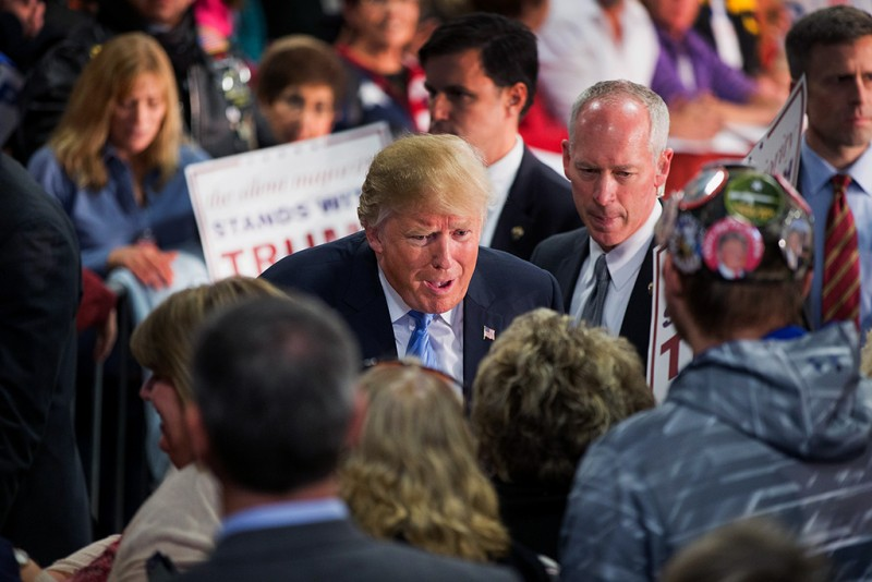 DAVENPORT, IA - DECEMBER 05:  Republican presidential candidate Donald Trump greets guests at a campaign event at Mississippi Valley Fairgrounds on December 5, 2015 in Davenport, Iowa. Trump continues to lead the most polls in the race for the Republican nomination for president.  (Photo by Scott Olson/Getty Images)