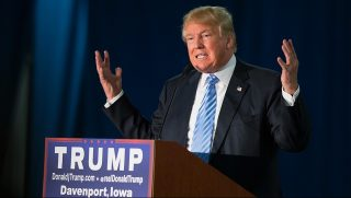 DAVENPORT, IA - DECEMBER 05:  Republican presidential candidate Donald Trump speaks to guests gathered for a campaign event at Mississippi Valley Fairgrounds on December 5, 2015 in Davenport, Iowa. Trump continues to lead the most polls in the race for the Republican nomination for president.  (Photo by Scott Olson/Getty Images)