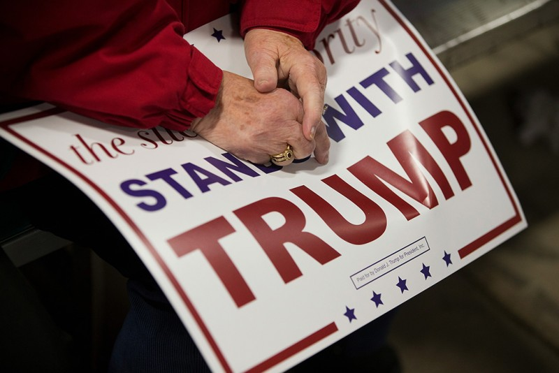 DAVENPORT, IA - DECEMBER 05:  Guests wait for Republican presidential candidate Donald Trump to speak at a campaign event at Mississippi Valley Fairgrounds on December 5, 2015 in Davenport, Iowa. Trump continues to lead the most polls in the race for the Republican nomination for president.  (Photo by Scott Olson/Getty Images)