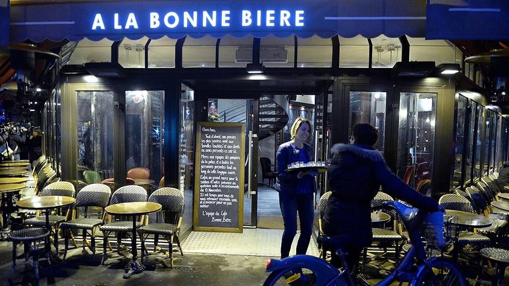PARIS, FRANCE - DECEMBER 04:  People arrive at 'La Bonne Biere', which re-opens today after the Paris terrorist attacks, on December 4, 2015 in Paris, France. Five people lost their lives at 'La Bonne Biere' during the November 13, 2015 terrorist attacks in Paris.  (Photo by Aurelien Meunier/Getty Images)