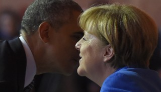 """US President Barack Obama speaks with German Chancellor Angela Merkel at the UN conference on climate change - COP21, on November 30, 2015 at Le Bourget, on the outskirts of the French capital Paris. World leaders opened an historic summit in the French capital  with """"the hope of all of humanity"""" laid on their shoulders as they sought a deal to tame calamitous climate change.   AFP PHOTO / ALAIN JOCARD / AFP / ALAIN JOCARD"""