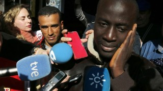 """Senegalese Ngame (R) addresses journalists after knowing he owns a winning lottery ticket of the Spanish Christmas' lottery draw on December 22, 2015 in the southeastern town of Roquetas de Mar. An unemployed Senegalese man named Ngame who was rescued by the Spanish coastguard after making a risky journey from Morocco eight years ago on a packed wooden boat, won 400,000 euros ($437,000) as he was one of the holders of one of the 1,600 tickets with the winning number -- 79140 -- in December 22 Spain's annual Christmas lottery draw, known as """"El Gordo"""" (The Fat One), newspaper La Voz de Almeria reported on December 23, 2015. AFP PHOTO / AFP / STRINGER"""