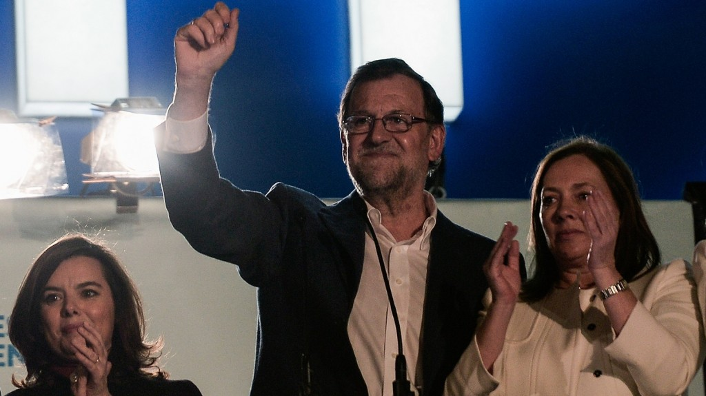 MADRID, SPAIN - DECEMBER 21:  Spanish Prime Minister and Popular Party (PP) leader, Mariano Rajoy (C) waves his hand as he gives a speech at his party headquarters'  balcony after his party won the most votes of the General Elections during a public meeting with supporters in Madrid, Spain on December 21, 2015. Spanish citizens went to the polls on 20th of December 2015 to vote for 350 members of the parliament and 208 senators. Popular Party won the elections but failed to reach overall majority. Burak Akbulut / Anadolu Agency
