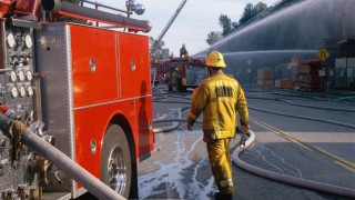 Firefighters and engines at fire