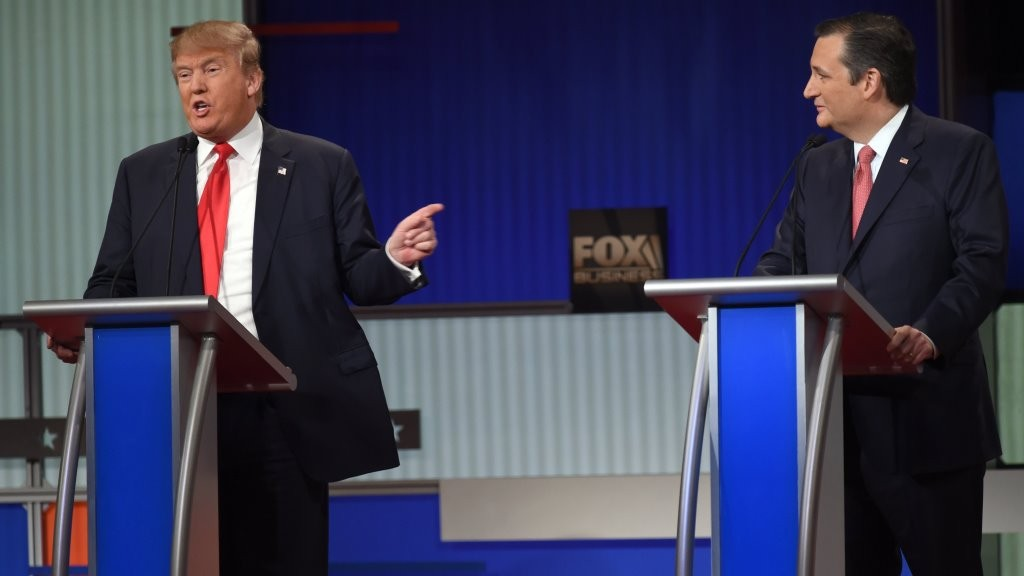 Republican Presidential candidate businessman Donald Trump (L) speaks next to Texas Senator Ted Cruz during the Republican Presidential debate sponsored by Fox Business and the Republican National Committee at the North Charleston Coliseum and Performing Arts Center in Charleston, South Carolina on January 14, 2016. / AFP / TIMOTHY A. CLARY
