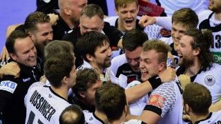 Players of Germany celebrate defeating Norway after the semi-final match of the Men's 2016 EHF European Handball Championship between Norway and Germany in Krakow on January 29, 2016. Germany won the match 33:34 after extra time and qualified for the final. / AFP / ATTILA KISBENEDEK