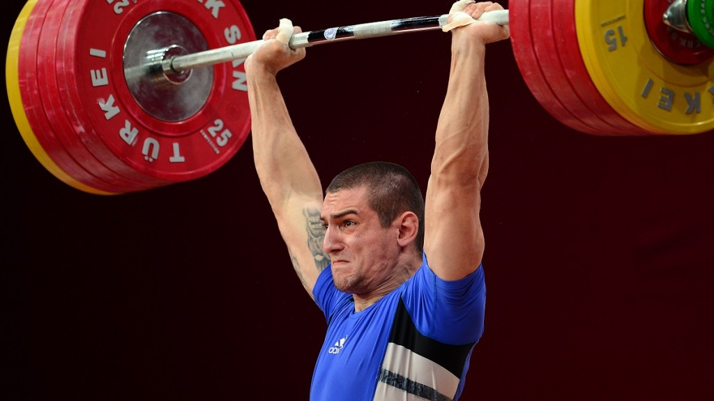 Ivan Markov of Bulgaria competes in the men's 85kg weightlifting IWF World Championships at Centennial Hall in Wroclaw, Poland on October 25, 2013. AFP PHOTO/JANEK SKARZYNSKI / AFP / JANEK SKARZYNSKI