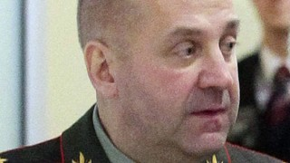 A picture taken on January 19, 2014, shows head of Russian Defence Ministry's Main Intelligence Department, better known under its Russian acronym of GRU,  Lieutenant General Igor Sergun walking in the GRU  headquarters in Moscow during a visit of Russia's President Dmitry Medvedev. US President Barack Obama announced yesterday sanctions against 20 Russian lawmakers and senior government officials, amid the worst crisis between Moscow and the West in years. Russia's military intelligence service head, Igor Sergun, was in the list. AFP PHOTO/ RIA-NOVOSTI/ KREMLIN POOL/ MIKHAIL KLIMENTYEV / AFP / RIA-NOVOSTI / MIKHAIL KLIMENTYEV