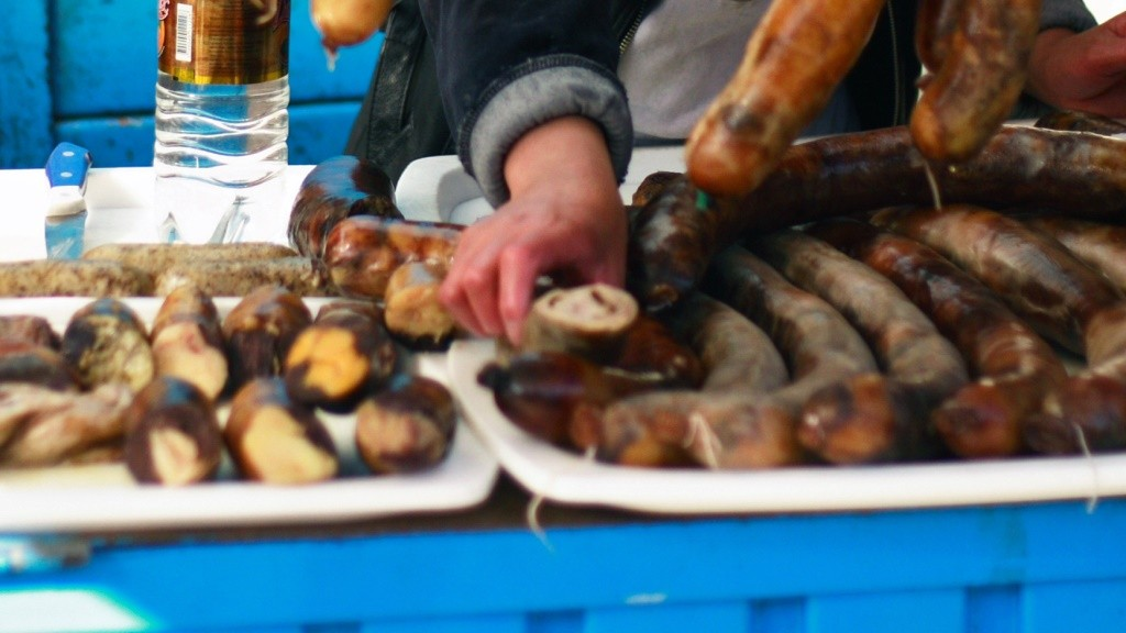 """A vendor sells sausages prepared from horse meat at Bishkek's Osh Bazaar on April 1, 2009. A Briton working at a Canadian-owned gold mine in Kyrgyzstan could face up to five years in jail for comparing a local delicacy to a horse penis, officials said on January 3. Michael Mcfeat, an employee of Toronto-based Centerra Gold, was detained by police after posting a comment on Facebook which caused a temporary strike at the Kumtor mine, an interior ministry spokesman told AFP. In the offending post, Mcfeat said his Kyrgyz colleagues were queueing for their """"special delicacy, the horse's penis"""" during holiday celebrations in reference to a traditional horse sausage known as """"chuchuk."""" AFP PHOTO / EVAN HARRIS / AFP / EVAN HARRIS"""