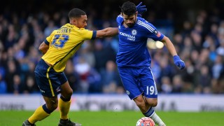 Scunthorpe's Jordan Clarke (L) vies with Chelsea's Brazilian-born Spanish striker Diego Costa during the FA Cup third-round football match between Chelsea and Scunthorpe United at Stamford Bridge in London on January 10, 2016.    AFP PHOTO / GLYN KIRK  RESTRICTED TO EDITORIAL USE. NO USE WITH UNAUTHORIZED AUDIO, VIDEO, DATA, FIXTURE LISTS, CLUB/LEAGUE LOGOS OR 'LIVE' SERVICES. ONLINE IN-MATCH USE LIMITED TO 75 IMAGES, NO VIDEO EMULATION. NO USE IN BETTING, GAMES OR SINGLE CLUB/LEAGUE/PLAYER PUBLICATIONS. / AFP / GLYN KIRK