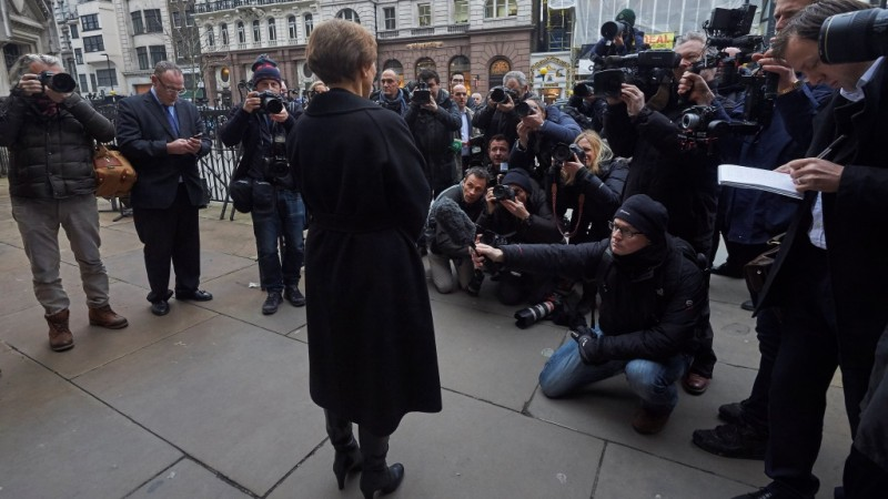 """Marina Litvinenko (C), widow of Russian former spy Alexander Litvinenko, addresses journalists outside the Royal Courts of Justice in central London on January 21, 2016.  Russian President Vladimir Putin """"probably approved"""" the radiation poisoning of former KGB agent Alexander Litvinenko in London, a British judge said  at the conclusion of a public inquiry into his agonising death. Litvinenko was allegedly poisoned at a hotel by a cup of tea laced with polonium-210 -- an extremely expensive radioactive isotope only available in closed nuclear facilities -- in a sequence of events which could have come from a Cold War thriller.    AFP PHOTO / NIKLAS HALLE'N / AFP / NIKLAS HALLE'N"""