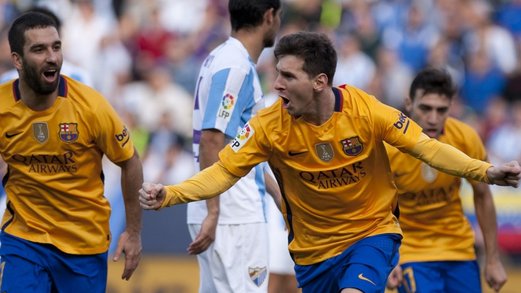 Barcelona's Argentinian forward Lionel Messi celebrates after scoring during the Spanish league football match Malaga CF vs FC Barcelona at La Rosaleda stadium in Malaga on January 23, 2016.  AFP PHOTO / JORGE GUERRERO / AFP / Jorge Guerrero