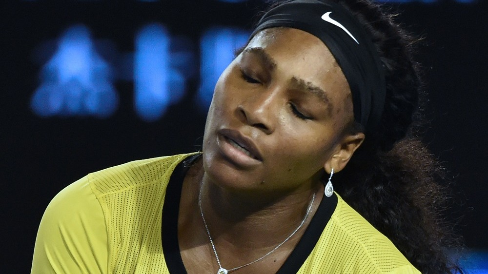 Serena Williams of the US reacts during her women's singles final match against Germany's Angelique Kerber on day thirteen of the 2016 Australian Open tennis tournament in Melbourne on January 30, 2016. AFP PHOTO / SAEED KHAN-- IMAGE RESTRICTED TO EDITORIAL USE - STRICTLY NO COMMERCIAL USE / AFP / SAEED KHAN