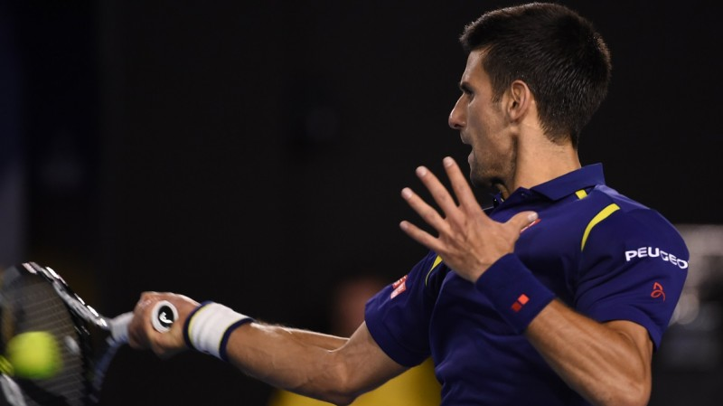 Serbia's Novak Djokovic plays a forehand return  during his men's singles final match against Britain's Andy Murray on day fourteen of the 2016 Australian Open tennis tournament in Melbourne on January 31, 2016. AFP PHOTO / WILLIAM WEST-- IMAGE RESTRICTED TO EDITORIAL USE - STRICTLY NO COMMERCIAL USE / AFP / WILLIAM WEST