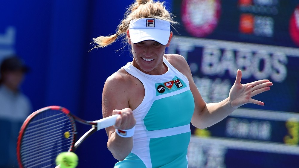Timea Babos of Hungary hits a return against Alison Riske of the US during their singles semi-final match at the Shenzhen Open WTA tennis tournament in Shenzhen, southern China's Guangdong province on January 8, 2016.                                  CHINA OUT    AFP PHOTO / AFP / STR