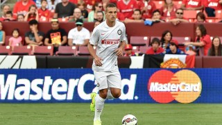 Inter Milan's Nemanja Vidic moves the ball during a Champions Cup match against Manchester United at FedEx Field in Landover, Maryland, on July 29, 2014.    AFP PHOTO/Nicholas KAMM / AFP / NICHOLAS KAMM