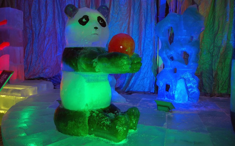View of a giant panda ice sculpture during the 32nd Harbin International Ice and Snow Festival in Harbin city, northeast China's Heilongjiang province, 5 January 2016.  In China's coolest annual tradition, Harbin has been transformed once again, for the 32nd time, into a magical winter wonderland for the world-famous International Ice and Snow Festival. The event opened to the public on Tuesday (5 January 2016) and will run until the end of February.