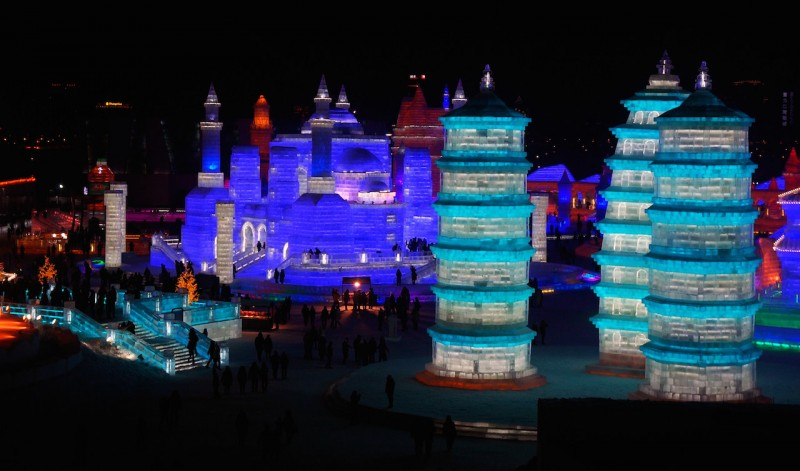 Night view of ice sculptures during the 32nd Harbin International Ice and Snow Festival in Harbin city, northeast China's Heilongjiang province, 5 January 2016.  In China's coolest annual tradition, Harbin has been transformed once again, for the 32nd time, into a magical winter wonderland for the world-famous International Ice and Snow Festival. The event opened to the public on Tuesday (5 January 2016) and will run until the end of February.