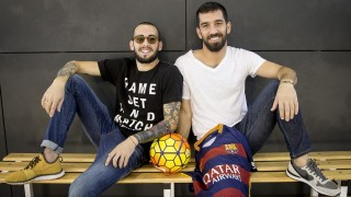 SANT JOAN DESPI, SPAIN - DECEMBER 30: Arda Turan (R) and Aleix Vidal (L) pose for a photo prior to the registration of two players after the end of the FIFA sanction to the FC Barcelona, in Sant Joan Despi, Spain on December 30, 2015. Barcelona can call on Arda Turan and Aleix Vidal for the first time after a Fifa-imposed ban on the club registering new players as they seek to breach Espanyol's resilient defence in the Copa del Rey on Wednesday. Albert Llop  / Anadolu Agency