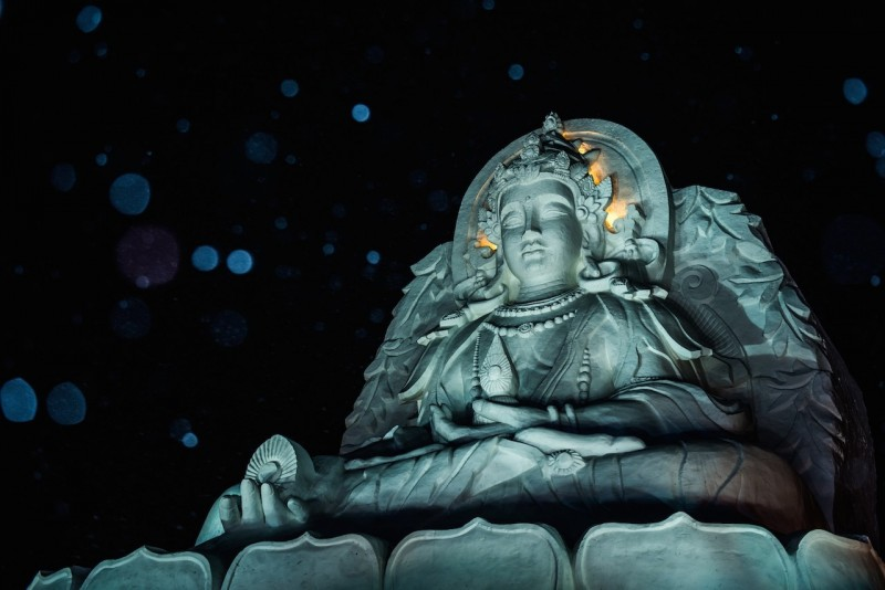 HARBIN, CHINA - JANUARY 6: A Buddah Sculpture is seen during the 32nd Harbin Ice Festival in Harbin, China on January 6, 2016. The main attraction is the Harbin Ice and Snow World, which covers more than 750,000 square meters. Its structures required more than 330,000 cubic meters of ice and snow to create Dave Randin / Anadolu Agency