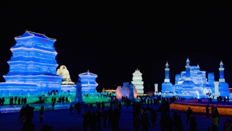 HARBIN, CHINA - JANUARY 6: Buddhist area is seen during the 32nd Harbin Ice Festival in Harbin, China on January 6, 2016. The main attraction is the Harbin Ice and Snow World, which covers more than 750,000 square meters. Its structures required more than 330,000 cubic meters of ice and snow to create Dave Randin / Anadolu Agency