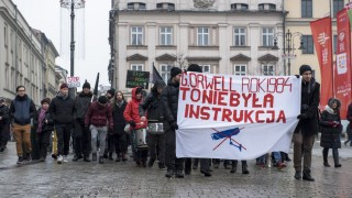 KRAKOW, POLAND - JANUARY 24: Protesters march with banners during an anti-government protest which especially highlights their reactions against internet surveillance law, on January 24, 2016 in Krakow, Poland. Omar Marques / Anadolu Agency