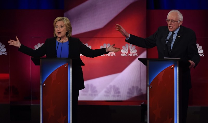 Democratic presidential candidates Hillary Clinton (L)  and Bernie Sanders (R) participate in the NBC News -YouTube Democratic Candidates Debate on January 17, 2016 at the Gaillard Center in Charleston, South Carolina.. / AFP / TIMOTHY A. CLARY