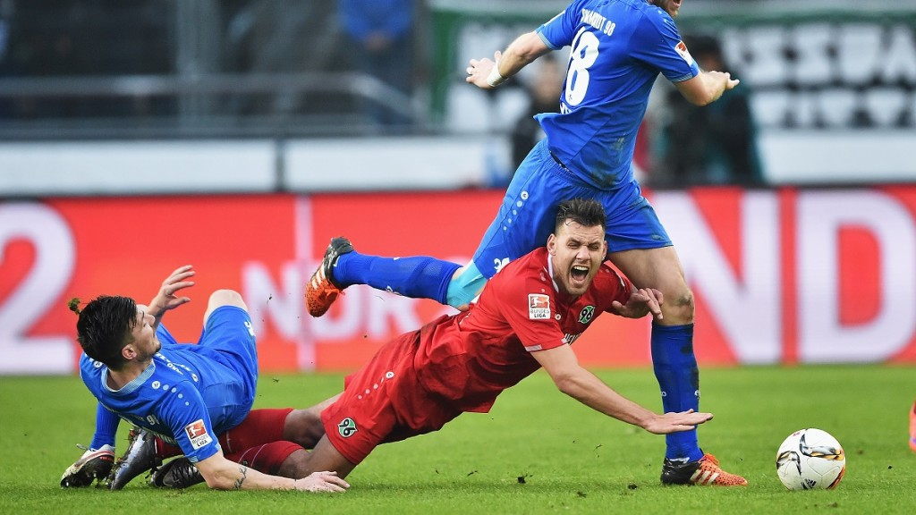 of Hannover is challenged by of Darmstadt during the Bundesliga match between Hannover 96 and SV Darmstadt 98 at HDI-Arena on January 23, 2016 in Hanover, Germany.
